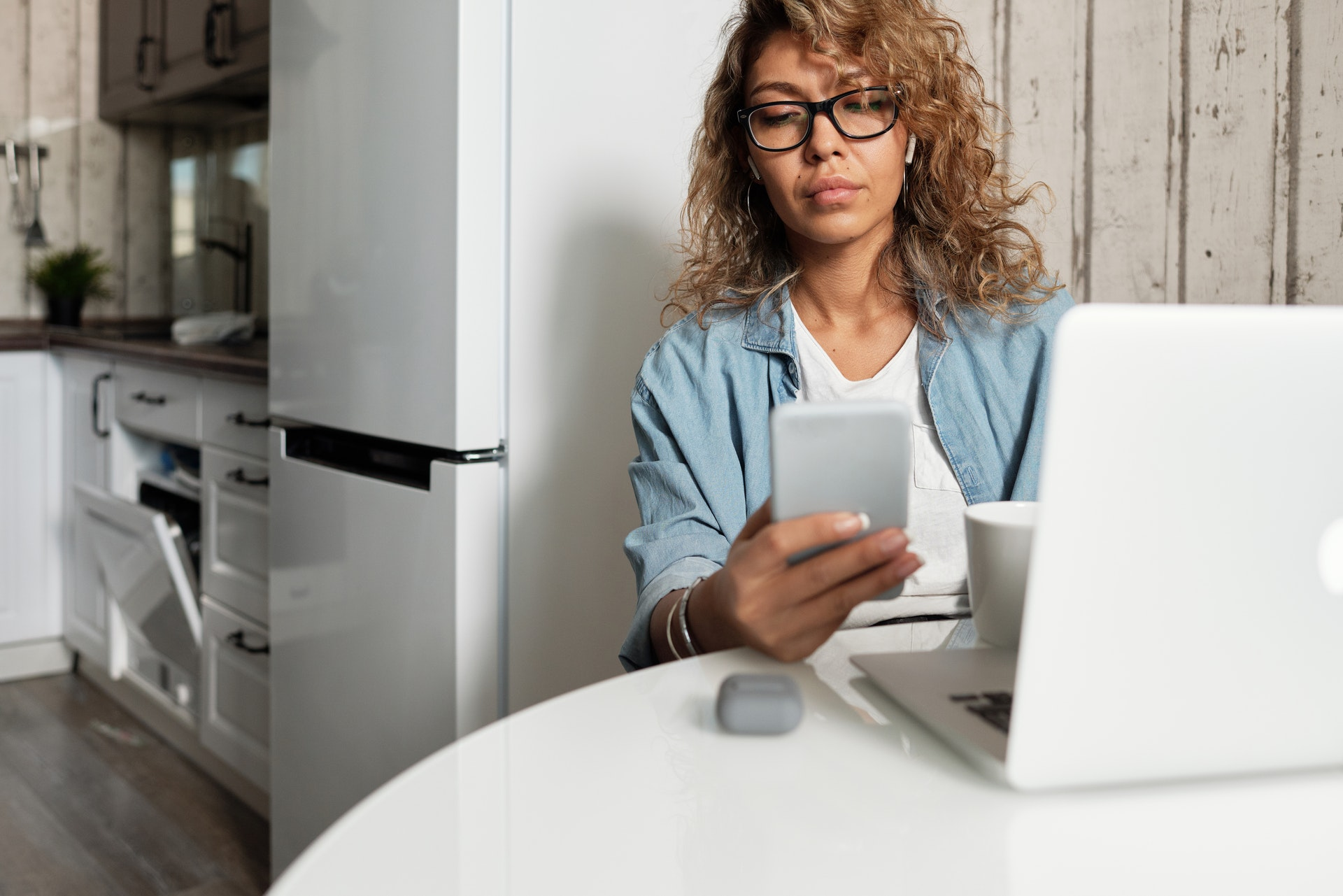 woman with phone at computer