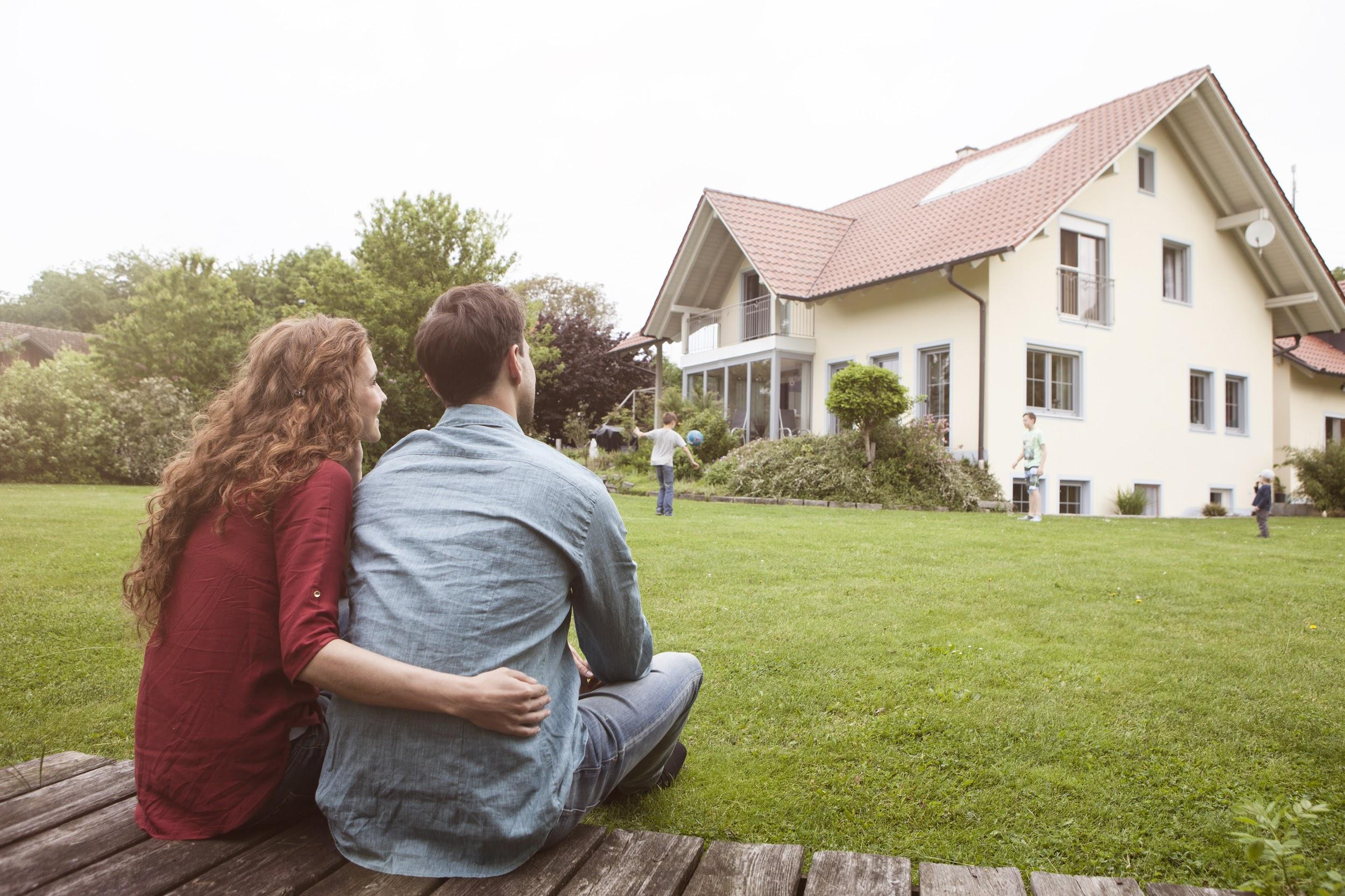 couple staring at house